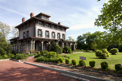 Historic Victorian mansion. The Southern Mansion in Cape May, NJ, built with historic Victorian architecture, with garden yard Stock Images