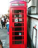 A red historic phone box in London. Stock Photography