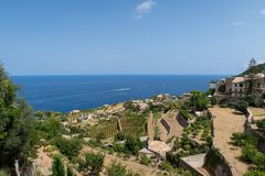 Historic village of Banyalbufar on Mallorca, Spain against blue sky and sea. On sunny summer day Stock Photos