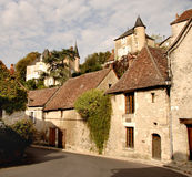 Historic Village in France. Historic medieval street in Rural France overlooked by two Chateau`s on the hill behind Stock Image