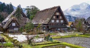 Shirakawago Historic Village in Gifu, Japan. Historic Village of Shirakawago with snow mountains in Gifu, Japan. Shirakawago has over 100 unique gossho-zukuri Stock Photo