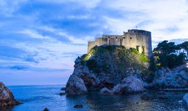The historic wall of Dubrovnik Old Town, Croatia. Prominent travel destination of Croatia. Dubrovnik old town UNESCO World. Heritage. Castle at night in the sea stock photos
