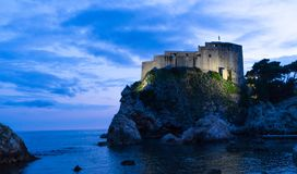 The historic wall of Dubrovnik Old Town, Croatia. Prominent travel destination of Croatia. Dubrovnik old town UNESCO World. Heritage. Castle at night in the sea stock images