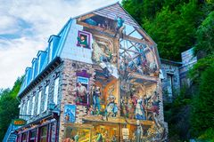 Historic Wall Mural Scene in Old Quebec City, Canada. OLD QUEBEC, CANADA - AUG 21, 2012: Famous trompe-l`oeil mural in the Lower Town of Old Quebec city known as stock image