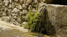 Historic wall and pure water at St Guilhem le Desert, Cevennes France stock video footage