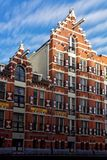 Historic Warehouse on a Canal in Amsterdam Royalty Free Stock Photo
