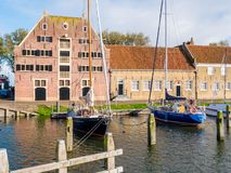 Historic warehouse and sailboats in east harbour of old town of Enkhuizen, North Holland, Netherlands. Historic warehouse and sailboats in east harbour of old royalty free stock photo