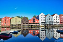 Historic warehouses on stilts from Trondheim with spectacular reflection. Water reflection of magnificent architecture on stilts downtown Trondheim, Norway Stock Image