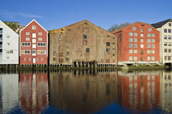 Historic warehouses, Trondheim, Norway. Colorful historic warehouses at the Nidelva river in the centre of Trondheim, Norway, Scandinavia Royalty Free Stock Photography