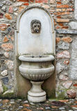Historic water fountain with a lion face Stock Photography