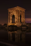 The historic water tower at the Peyrou, Montpellier, France. A night picture of the water tower, shaped as a greek monument, on the place du Peyrou, in royalty free stock images