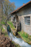 Historic water wheel at work stock photography