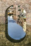 Watergate in Zutphen, The Netherlands. Historic watergate in the city of Zutphen, The Netherlands reflecting in the canal that runs through it Royalty Free Stock Photo
