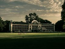 Historic white building with big lawn and sky background royalty free stock images