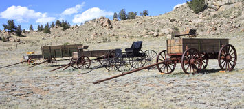 Historic wild west wagons. Collection of five authentic antique wild west four-wheeled wagons in Colorado, America Royalty Free Stock Image
