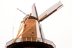 Historic wind Mill in perspective Royalty Free Stock Photos