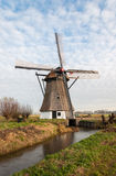 Historic windmill in a Dutch polder landscape Stock Photography