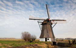 Historic windmill in a Dutch polder landscape Stock Photos