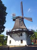Historic windmill in front of blue sky stock image