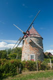 Historic windmill on Ile-aux-coudres Stock Image
