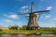 Historic windmill in Nieuwe Wetering. Historic windmill in a blue and clowdy sky in Nieuwe Wetering in the Netherlands royalty free stock images