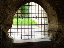 A historic window with metal bars Royalty Free Stock Images