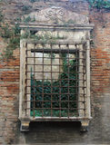 Historic window opening with bars in ancient roman house Stock Photos