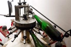 Historic wine bottling machine Stock Photo