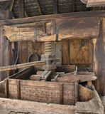 Historic wine press. Detail of a historic wooden wine press, seen in Alsace (France royalty free stock image