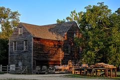Historic Wood and Lumber Sawmill in Old Village Stock Photography