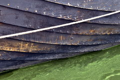 Historic wooden boat. Wolin, Poland: Historic wooden boat submerged in greenish water royalty free stock images