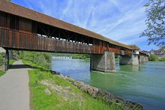 Historic wooden bridge. The historic covered wooden bridge over the river Rhine from Bad Saeckingen to Switzerland Royalty Free Stock Image