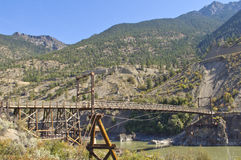 An historic wooden bridge spanning the Fraser River Stock Photo
