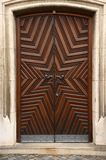 Historic wooden doors. With detail of star Stock Photography