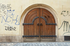 The historic wooden gate. In the wall scribbled vandals Royalty Free Stock Photography
