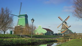 Historic wooden houses and windmills at the Zaanse Schans. Holland 4K stock footage