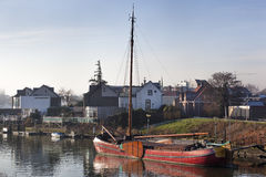 Historic wooden ship moored in dutch village Royalty Free Stock Photography