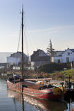 Historic wooden ship moored in dutch village Stock Image