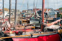 Historic wooden ships in harbor of Urk, old Dutch fishing village Stock Photo