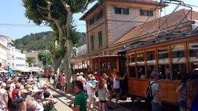 Historic wooden tram in Port de Soller, Mallorca, Spain. Port de Soller, Mallorca, Spain - June 21, 2018: Historic wooden tram in Port de Soller and a lot of Royalty Free Stock Image