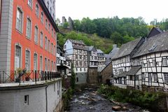 Historic wooden tudor style buildings at Rur river in Monschau Stock Image