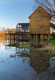 Historic wooden watermill with reflection. Stock Photography