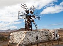 Historic wooden wind mill near the village Puerto Lajas on the Spanish island Fuerteventura Royalty Free Stock Photo