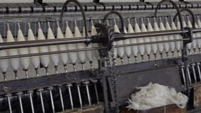 Historic woolen mill production in Wales - United Kingdom. Historic woolen mill production in Trefriw, Wales - United Kingdom stock footage