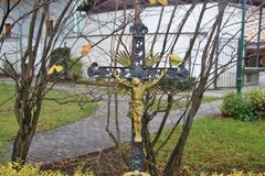Historic wrought-iron cross with images of Saints and angels. Austria. Historic wrought-iron cross with images of Saints and angels. In front of the saint john stock photo