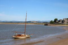 Historic yacht by beach on River Kent, Arnside. Historic old yacht, Severn, built in Arnside in 1912 and now owned by Arnside sailing club on the River Kent at royalty free stock photos