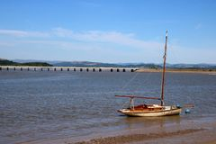 Historic yacht River Kent Arnside viaduct Cumbria. Historic old yacht, Severn, built in Arnside in 1912 and now owned by Arnside sailing club on the River Kent royalty free stock image