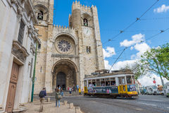 Historic yellow tram in front of the Lisbon Cathedral Royalty Free Stock Photography