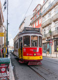 Historic yellow tram in front of the Lisbon Stock Images