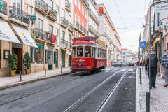 Historic yellow tram in front of the Lisbon Stock Photography